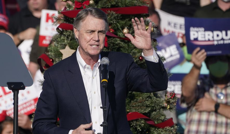 "In this Dec. 10, 2020, file photo, Sen. David Perdue, R-Ga., speaks during a ""Save the Majority"" rally in Augusta, Ga. Perdue says he won't run in 2022 to reclaim a seat in the U.S. Senate. The announcement came Tuesday, Feb. 23, 2021, eight days after the defeated Republican filed campaign paperwork that could have opened the way for him to run against Democratic Sen. Raphael Warnock. (AP Photo/John Bazemore, File)"