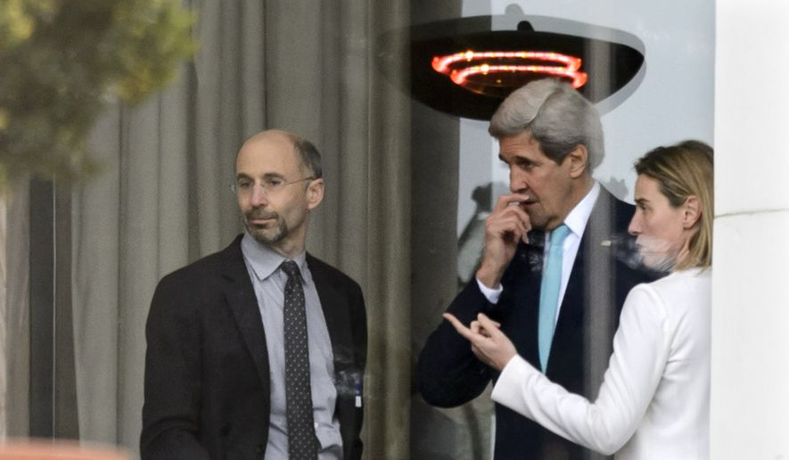 In this file photo from April 1, 2015, High Representative of the European Union for Foreign Affairs and Security Policy Federica Mogherini, right, speaks with then-U.S. Secretary of State John Kerry, center, and U.S. Robert Malley, left, Senior Director for Iran, Iraq, and the Gulf States, National Security Council during a break outside the hotel at the Beau Rivage Palace Hotel as the Iran nuclear talks continue, in Lausanne, Switzerland, Wednesday, April 1, 2015. Malley currently serves as the Biden administration's special envoy to Iran and is working to salvage the Obama-era Iran deal that President Trump canceled. (AP Photo/Keystone,Laurent Gillieron)  ** FILE **