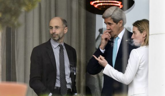 In this file photo from April 1, 2015, High Representative of the European Union for Foreign Affairs and Security Policy Federica Mogherini, right, speaks with U.S. Secretary of State John Kerry, center, and U.S. Robert Malley, left, Senior Director for Iran, Iraq, and the Gulf States, National Security Council during a break outside the hotel at the Beau Rivage Palace Hotel as the Iran nuclear talks continue, in Lausanne, Switzerland, Wednesday, April 1, 2015. Malley currently serves as the Biden administration's special envoy to Iran and is working to salvage the Obama-era Iran deal that President Trump canceled. (AP Photo/Keystone,Laurent Gillieron)  **FILE**