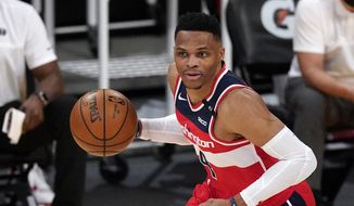 Washington Wizards guard Russell Westbrook dribbles during the second half of an NBA basketball game against the Los Angeles Lakers Monday, Feb. 22, 2021, in Los Angeles. The Wizards won 127-124 in overtime. (AP Photo/Mark J. Terrill)