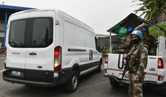 A van containing the body of Italian ambassador to Congo Luca Attanasio arrives at the airport to be transported to the capital Kinshasa, in Goma, North Kivu province, Congo, Tuesday, Feb. 23, 2021. Congo has dispatched a team to support investigators on the ground in Goma where the Italian ambassador to Congo, an Italian Carabinieri police officer and their driver were ambushed and killed Monday. A specialized Italian Carabinieri unit is expected in Congo Tuesday to look into the killings with the support of the Congolese authorities and the United Nations Mission in Congo. (AP Photo)