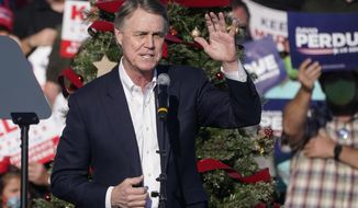 """FILE - In this Dec. 10, 2020 file photo, Sen. David Perdue, R-Ga., speaks during a """"Save the Majority"""" rally in Augusta, Ga.  Perdue says he won't run in 2022 to reclaim a seat in the U.S. Senate. The announcement came Tuesday, Feb. 23, 2021, eight days after the defeated Republican filed campaign paperwork that could have opened the way for him to run against Democratic Sen. Raphael Warnock.(AP Photo/John Bazemore, File)"""