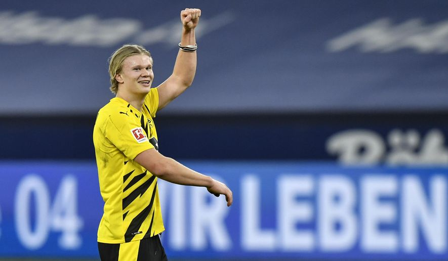 Dortmund's scorer Erling Haaland celebrates after winning the German Bundesliga soccer match between FC Schalke 04 and Borussia Dortmund in Gelsenkirchen, Germany, Saturday, Feb. 20, 2021. (AP Photo/Martin Meissner, Pool)