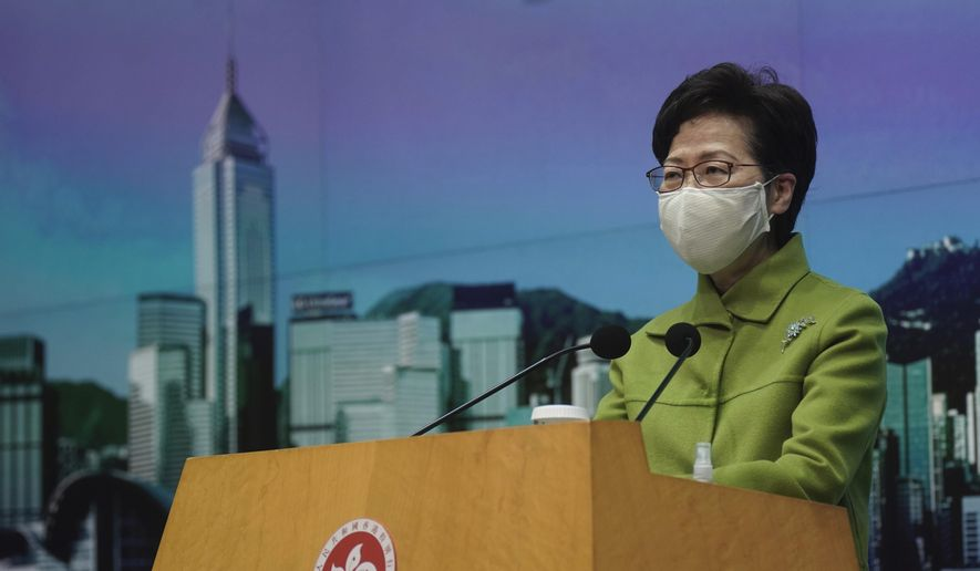 In this Jan. 26, 2021, file photo, Hong Kong Chief Executive Carrie Lam listens to reporters' questions during a press conference in Hong Kong. (AP Photo/Vincent Yu, File)