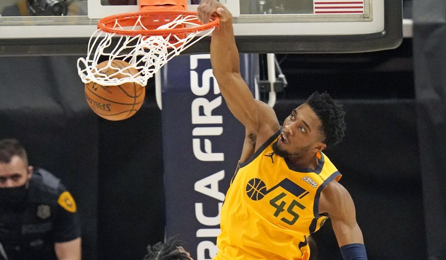 Utah Jazz guard Donovan Mitchell (45) dunks against the Charlotte Hornets in the second half during an NBA basketball game Monday, Feb. 22, 2021, in Salt Lake City. (AP Photo/Rick Bowmer)