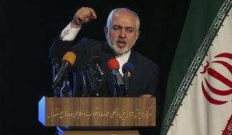 Iran's Foreign Minister Mohammad Javad Zarif addresses in a conference in Tehran, Iran, Tuesday, Feb. 23, 2021. Following the conference, Zarif told journalists the country has started implementing a law passed by the parliament to curb UN inspections into its nuclear program and would no longer share surveillance footage of its nuclear facilities with the U.N. agency. (AP Photo/Vahid Salemi)