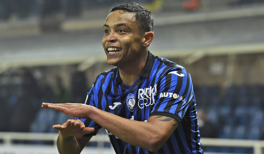 Atalanta's Luis Muriel celebrates after scoring his side's third goal during a Serie A soccer match between Atlanta and Napoli, in Bergamo's Atleti Azzurri d'Italia stadium, Italy, Sunday, Feb. 21, 2021. (Gianluca Checchi/LaPresse via AP)