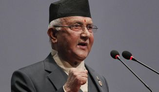 FILE- In this Oct. 11, 2015 file photo, Nepal's Khadga Prasad Oli addresses parliament before being appointed as the new Prime Minister in Kathmandu, Nepal. Nepal's supreme court on Tuesday, Feb. 23, 2021, ordered reinstating parliament that was dissolved by Prime Minister Oli that is likely to push the Himalayan nation to a political crisis. (AP Photo/Niranjan Shrestha, File)