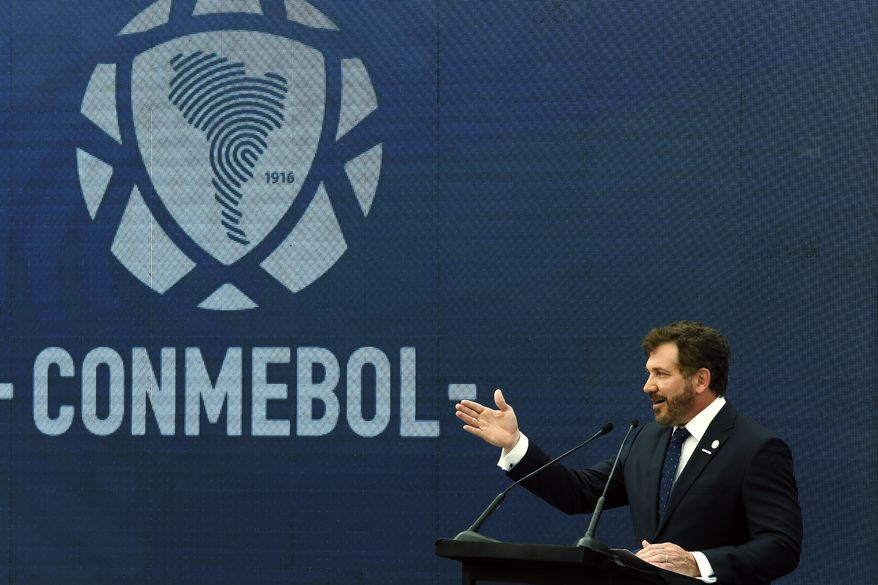 Conmebol's President Alejandro Dominguez speaks during a re- inauguration ceremony at the headquarters of the South American Football Confederation, known by its acronym CONMEBOL, in Luque, Paraguay, Wednesday, Nov. 25, 2020. (AP Photo/Jorge Saenz)