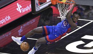 Detroit Pistons forward Sekou Doumbouya (45) dunks the ball during the second half of an NBA basketball game against the Orlando Magic, Tuesday, Feb. 23, 2021, in Orlando, Fla. (AP Photo/Phelan M. Ebenhack)