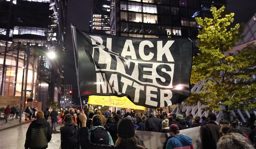FILE - In this Nov. 4, 2020, file photo, protesters representing Black Lives Matter and Protect the Results march in Seattle. A financial snapshot shared exclusively with The Associated Press shows the Black Lives Matter Global Network Foundation raked in just over $90 million last year. (AP Photo/Ted S. Warren, File)