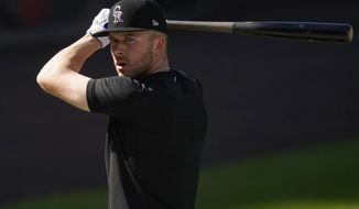FILE - Colorado Rockies shortstop Trevor Story warms up before a baseball game against the Los Angeles Angels in this file photograph taken Saturday, Sept. 12, 2020, in Denver. Story, who will be a free agent at the end of the 2021 season, has become the face of the franchise with the trade of third baseman Nolan Arenado to St. Louis. (AP Photo/David Zalubowski, File)