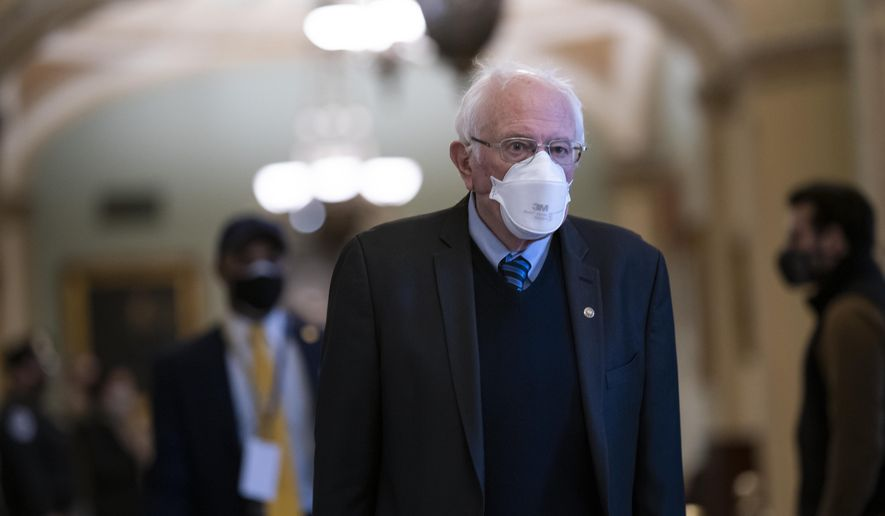 Sen. Bernie Sanders, I-Vt., chair of the Senate Budget Committee, arrives as the Senate convenes in a rare weekend session for final arguments in the second impeachment trial of former President Donald Trump, at the Capitol in Washington, Saturday, Feb. 13, 2021. (AP Photo/J. Scott Applewhite)