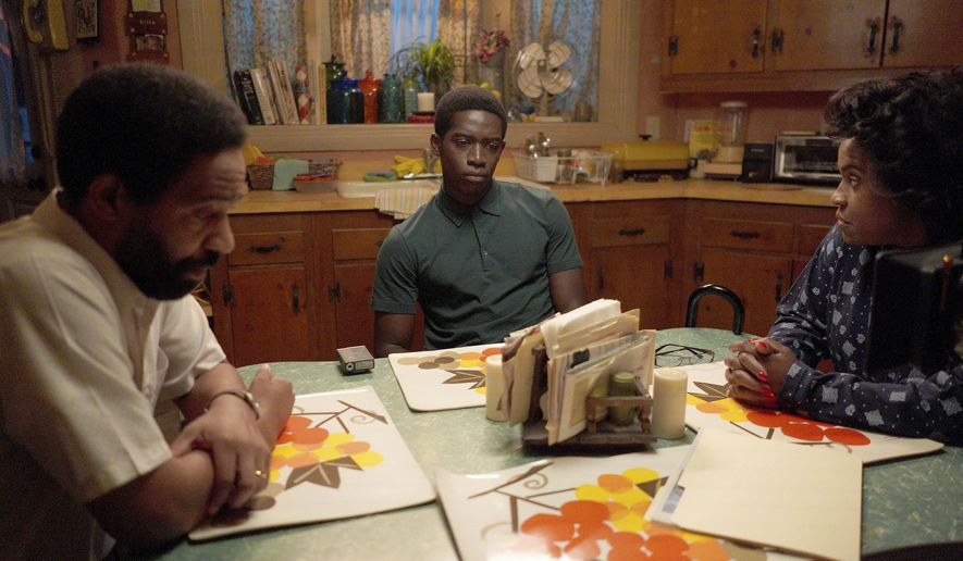 """This image released by FX shows, from left, Kevin Carroll as Alton, Damson Idris as Franklin Saint, and Michael Hyatt as Cissy Saint in a scene from """"Snowfall."""" Season four premiers on FX on Wednesday, and Thursday on FX on Hulu. (Byron Cohen/FX via AP)"""
