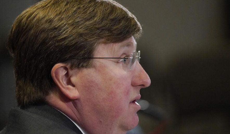 Gov. Tate Reeves answers a reporter's question during his media update on the current situation of COVID-19 in Mississippi, Tuesday, Feb. 23, 2021, in Jackson, Miss. (AP Photo/Rogelio V. Solis)