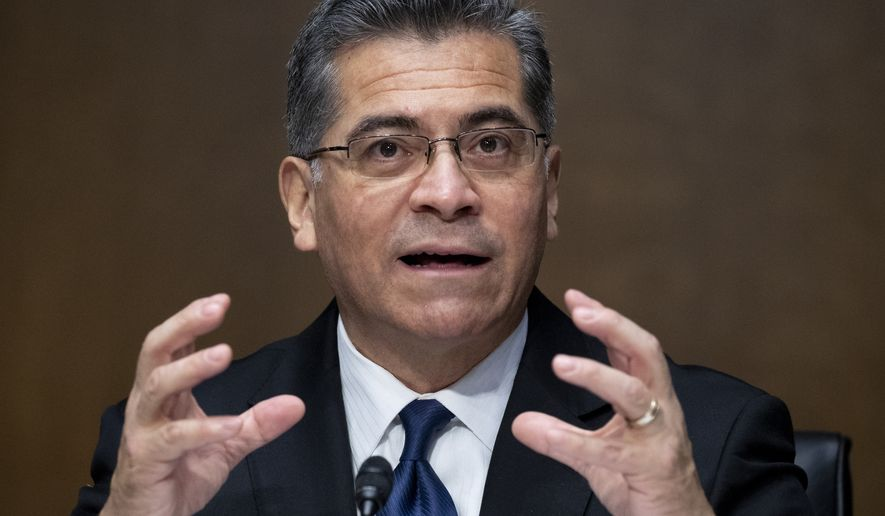 Xavier Becerra testifies during a Senate Finance Committee hearing on his nomination to be Secretary of Health and Human Services on Capitol Hill in Washington, Wednesday, Feb. 24, 2021. (Michael Reynolds/Pool via AP)
