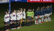 Players from the United States, left, and Argentina teams stand during the national anthems before a SheBelieves Cup women's soccer match, Wednesday, Feb. 24, 2021, in Orlando, Fla. (AP Photo/Phelan M. Ebenhack)
