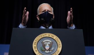 In this Feb. 11, 2021, file photo, President Joe Biden speaks during a visit to the Viral Pathogenesis Laboratory at the National Institutes of Health in Bethesda, Md. A federal judge late Tuesday, Feb. 23, 2021,  indefinitely banned President Joe Biden's administration from enforcing a 100-day moratorium on most deportations. (AP Photo/Evan Vucci, File)