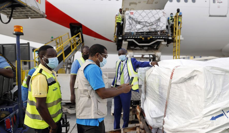 This photograph released by UNICEF Wednesday Feb. 24, 2021, shows the first shipment of COVID-19 vaccines distributed by the COVAX Facility arriving at the Kotoka International Airport in Accra, Ghana. Ghana has become the first country in the world to receive vaccines acquired through the United Nations-backed COVAX initiative with a delivery of 600,000 doses of the AstraZeneca vaccine made by the Serum Institute of India. (Francis Kokoroko/UNICEF via AP)