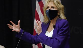 First lady Jill Biden gestures as she speaks during a visit to the Massey Cancer center at Virginia Commonwealth University for a discussion about cancer disparities. in Richmond, Va., Wednesday, Feb. 24, 2021. (AP Photo/Steve Helber)