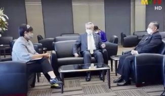 In this image taken from MRTV video Indonesian Foreign Minister Retno Marsudi, left, talks with Thailand Foreign Minister Don Pramudwinai, center, and Myanmar's Foreign Minister Wunna Maung Lwin, right, during their meeting in Bangkok, Thailand, Wednesday, Feb. 24, 2021. Regional diplomatic efforts to resolve Myanmar's political crisis gathered pace Wednesday, while protests continued in Yangon and other cities calling for the country's coupmakers to stand down and Aung San Suu Kyi's elected government to be returned to power. (MRTV via AP)