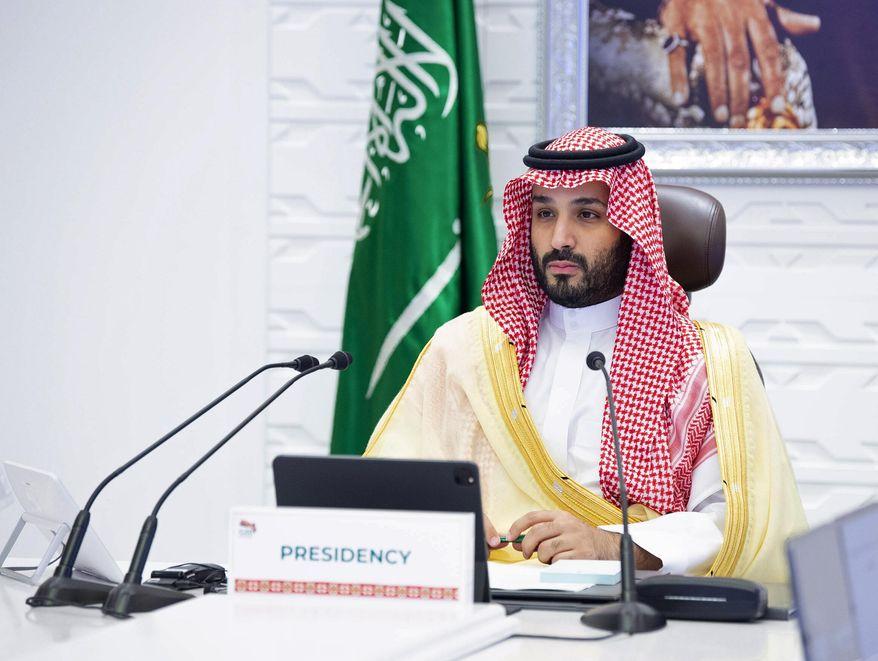 In this Sunday, Nov. 22, 2020, file photo, Saudi Arabia's Crown Prince Mohammed bin Salman attends a virtual G-20 summit held over video conferencing, in Riyadh, Saudi Arabia. (Bandar Aljaloud/Saudi Royal Palace via AP, File)