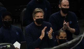 Minnesota Timberwolves head coach Chris Finch reacts during the first half of an NBA basketball game against the Milwaukee Bucks Tuesday, Feb. 23, 2021, in Milwaukee. (AP Photo/Morry Gash)