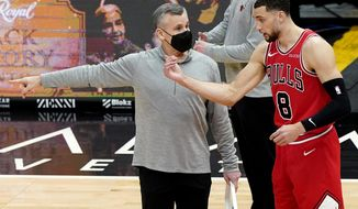 Chicago Bulls head coach Billy Donovan, left, talks with guard Zach LaVine before an NBA basketball game against the Minnesota Timberwolves in Chicago, Wednesday, Feb. 24, 2021. (AP Photo/Nam Y. Huh)