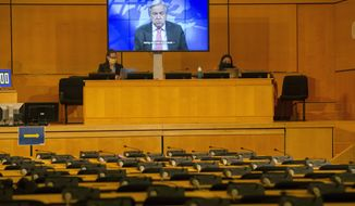 A screen shows U.N. Secretary-General Antonio Guterres making his statement by video, during the opening of the 46th session of the Human Rights Council, at the European headquarters of the United Nations in Geneva, Switzerland, Monday Feb. 22, 2021. (Salvatore Di Nolfi/Keystone via AP)