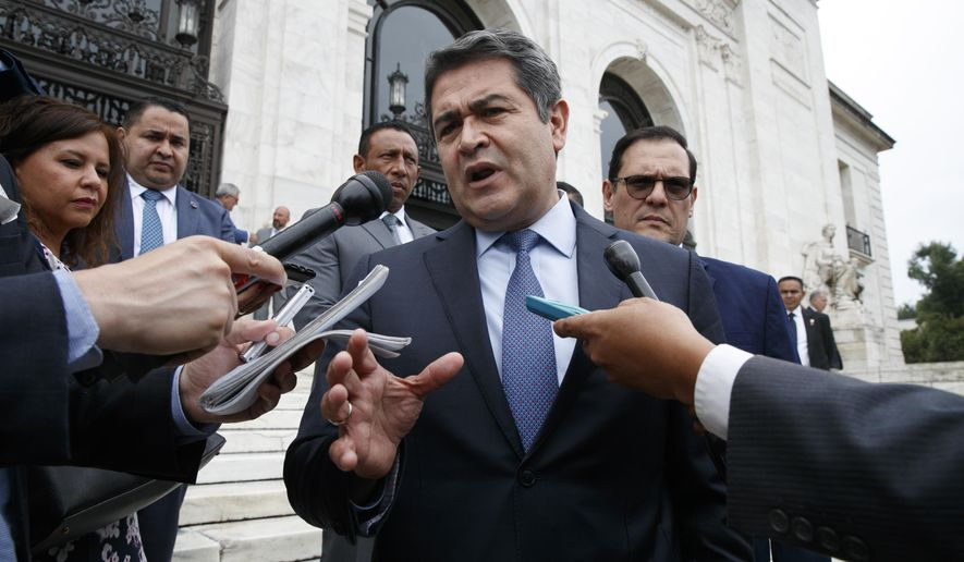 FILE - In this Aug. 13, 2019 file photo, Honduran President Juan Orlando Hernandez speaks to the reporters as he leaves a meeting at the Organization of American States, in Washington.  Newly proposed U.S. legislation introduced Tuesday, Feb. 23, 2021, targets Orlando Hernandez as allegations of ties to drug trafficking grow. (AP Photo/Jacquelyn Martin, File)