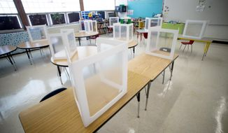 Desks are set up within social distancing and COVID-19 protocols on Tuesday, Feb. 23, 2021 at McMonagle Elementary School in Mt. Morris Township, Mich. (Jake May/The Flint Journal via AP) ** FILE **