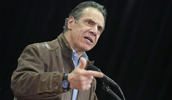 New York Gov. Andrew Cuomo speaks during a press conference before the opening of a mass COVID-19 vaccination site in the Queens borough of New York, Wednesday, Feb. 24, 2021. This FEMA run site, along with another in Brooklyn, gives priority to local residents in an effort to equitably distribute the vaccine. (AP Photo/Seth Wenig, Pool)
