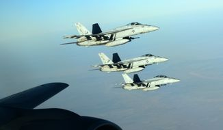 A formation of U.S. Navy F-18E Super Hornets leaves after receiving fuel from a KC-135 Stratotanker over northern Iraq, Sept. 23, 2014. These aircraft were part of a large coalition strike package that was the first to strike ISIL targets in Syria. (U.S. Air Force photo by Staff Sgt. Shawn Nickel)