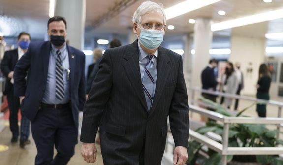 Senate Minority Leader Mitch McConnell, R-Ky., arrives for votes on President Joe Biden's cabinet nominees, at the Capitol in Washington, Thursday, Feb. 25, 2021. (AP Photo/J. Scott Applewhite)