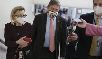 Reporters reach out to Sen. Joe Manchin III, D-W.Va., as he arrives for votes on President Joe Biden's Cabinet nominees, at the Capitol in Washington, Thursday, Feb. 25, 2021. (Associated Press)