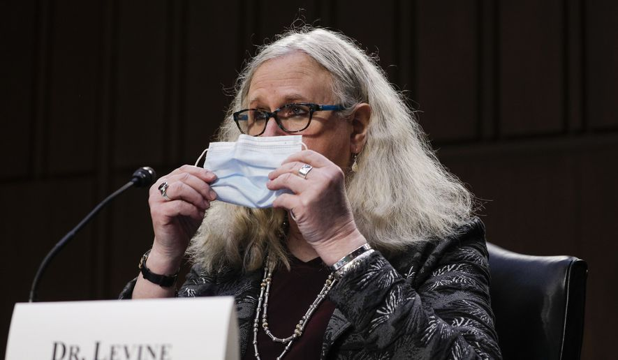 Dr. Rachel Levine, nominated to be an assistant secretary at the Department of Health and Human Services, holds her face mask as she testifies before the Senate Health, Education, Labor, and Pensions Committee on Capitol Hill in Washington on Thursday, Feb. 25, 2021. (Tom Brenner/Pool via AP) ** FILE **