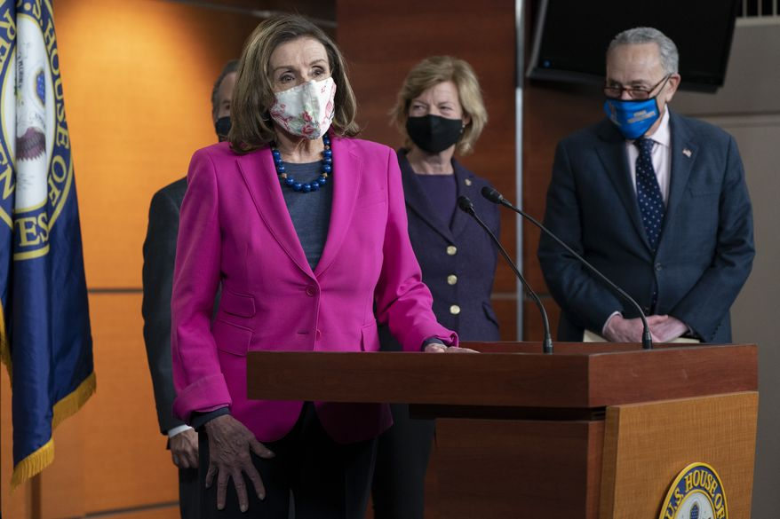 House Speaker Nancy Pelosi of Calif., left, with Sen. Tammy Baldwin, D-Wis., center, and Senate Majority Leader Chuck Schumer, D-N.Y., speaks about the Congress Equality Act, Thursday, Feb. 25, 2021, on Capitol Hill in Washington. Behind Pelosi is Rep. David Cicilline, D-Rhode Island. (AP Photo/Jacquelyn Martin)