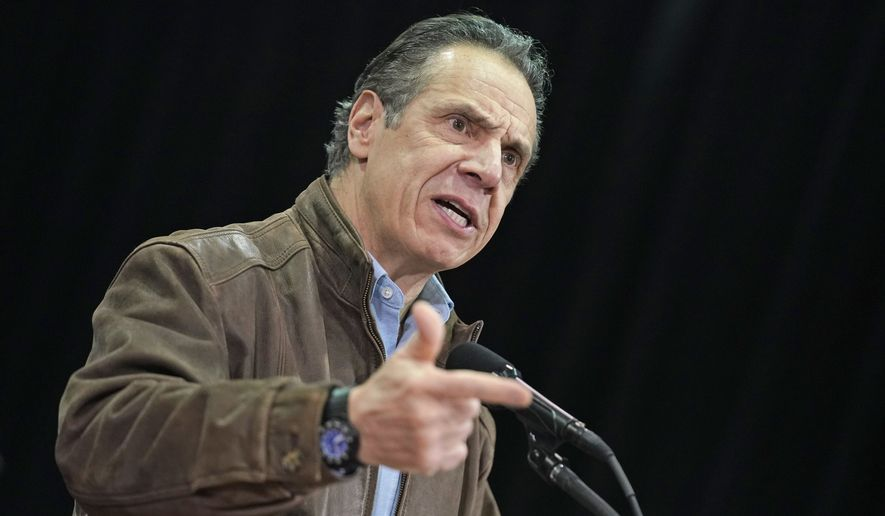 In this Wednesday, Feb. 24, 2021, file photo, New York Gov. Andrew Cuomo speaks during a press conference before the opening of a mass COVID-19 vaccination site in the Queens borough of New York. A former aides allegations that Gov. Cuomo subjected her to an unwanted kiss during years of sexual harassment have spurred calls for an investigation  and questions about who might meaningfully conduct one. (AP Photo/Seth Wenig, Pool, File)