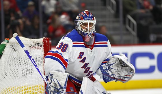 In this Feb. 1, 2020, file photo, New York Rangers goaltender Henrik Lundqvist plays against the Detroit Red Wings in the second period of an NHL hockey game in Detroit. Lundqvist says he is months away from making a decision about his hockey-playing future after returning to the ice less than two months since undergoing open-heart surgery. (AP Photo/Paul Sancya, File)  **FILE**