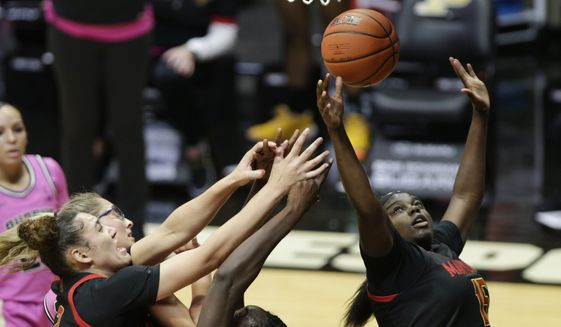 Maryland guard Ashley Owusu (15) grabs a rebound during the third quarter of the team's NCAA college basketball game against Purdue on Thursday, Feb. 25, 2021, in West Lafayette, Ind. (Nikos Frazier/Journal & Courier via AP)