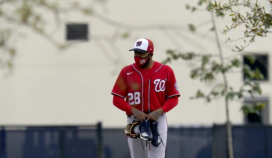 Washington Nationals pitcher Jeremy Jeffress walks out for spring training baseball practice Thursday, Feb. 25, 2021, in West Palm Beach, Fla. (AP Photo/Jeff Roberson) **FILE**