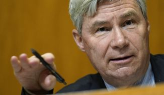 Sen. Sheldon Whitehouse, D-R.I., speaks during a Senate Budget Committee hearing on Capitol Hill in Washington, Thursday, Feb. 25, 2021, examining wages at large profitable corporations. (AP Photo/Susan Walsh, Pool)