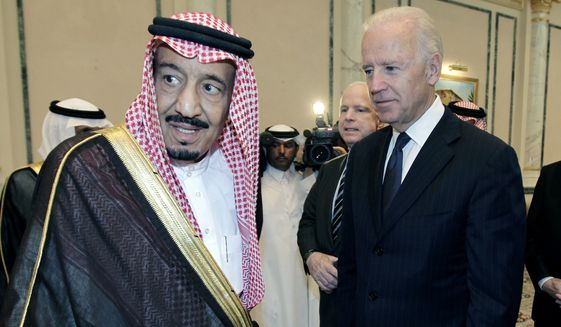 In this Oct. 27, 2011, file photo, then U.S. Vice President Joe Biden, right, offers his condolences to then Prince Salman bin Abdel-Aziz upon the death of his brother Saudi Crown Prince Sultan bin Abdul-Aziz Al Saud, at Prince Sultan palace in Riyadh, Saudi Arabia. President Joe Biden is expected to speak to Saudi King Salman for the first time in Biden's just over a month-old administration. (AP Photo/Hassan Ammar) ** FILE **