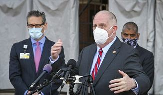 Maryland Gov. Larry Hogan speaks with news media outside M&T Bank Stadium after touring the site on the first day of a mass vaccination clinic, Thursday, Feb. 25, 2021, in Baltimore. (Kenneth K. Lam/The Baltimore Sun via AP) **FILE**