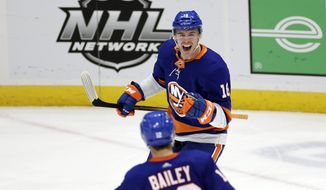 New York Islanders left wing Anthony Beauvillier celebrates scoring a goal against the Boston Bruins during the third period of an NHL hockey game, Thursday, Feb. 25, 2021, in Uniondale, N.Y. (AP Photo/Adam Hunger)