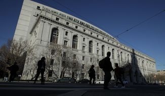 FILE - In this Jan. 7, 2020, file photo, is the Earl Warren Building, headquarters of the Supreme Court of California, in San Francisco. The California Supreme Court on Thursday, Feb. 25, 2021, upheld the state's 2018 law barring 14 and 15-year-olds from being tried as adults and sent to adult prisons even for serious crimes like murder, arson and robbery, rape or kidnapping. (AP Photo/Jeff Chiu, File)
