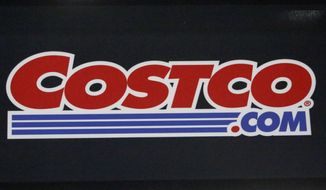 A Costco sign is seen on the wall of a new store in Ridgeland, Miss., Thursday, March 12, 2020. Costco will increase its starting wage to $16 an hour, surpassing most of its main competitors at a time when efforts to raise the minimum wage are gaining traction in the U.S. Costco CEO  Craig Jelinek announced the increase Thursday, Feb. 25, 2021, at a Senate Budget Committee hearing, led by Sen. Bernie Sanders, to examine wages at major companies. (AP Photo/Rogelio V. Solis)