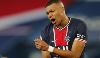 PSG's Kylian Mbappe reacts during the French League One soccer match between Paris Saint Germain and Monaco, at the Parc des Princes stadium, in Paris, France, Sunday, Feb. 21, 2021. (AP Photo/Francois Mori)