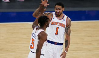 New York Knicks guard Immanuel Quickley (5) celebrates with forward Obi Toppin (1) after scoring the first half of the team's NBA basketball game against the Sacramento Kings, Thursday, Feb. 25, 2021, in New York. (AP Photo/John Minchillo, Pool)