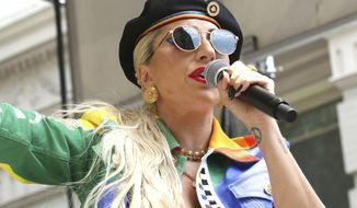 This June 28, 2019 file photo shows Lady Gaga performing in the second annual Stonewall Day honoring the 50th anniversary of the Stonewall riots, hosted by Pride Live and iHeartMedia in New York. Officials say Lady Gaga's dog walker was shot and her two French bulldogs stolen in Hollywood during an armed robbery. Los Angeles police are seeking two suspects, thought it's not known if both were armed, in connection with the Wednesday night shooting. (Photo by Greg Allen/Invision/AP, File)